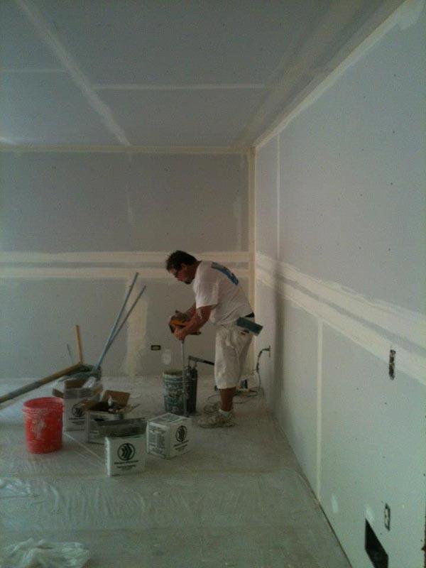 adding mud to walls
