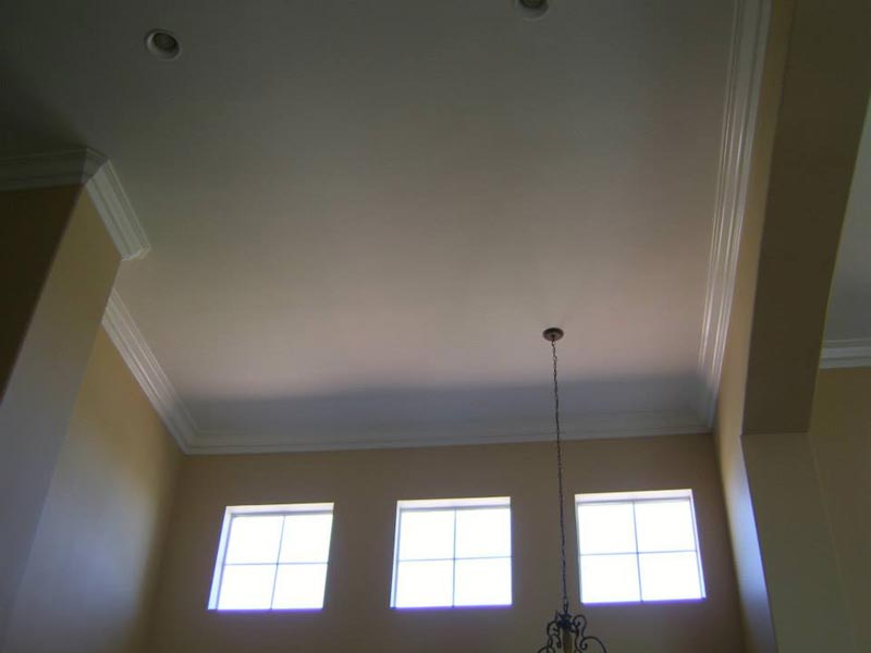 Refinished and painted cathedral ceiling in living room